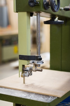 jig saw machine sawing board at workshop