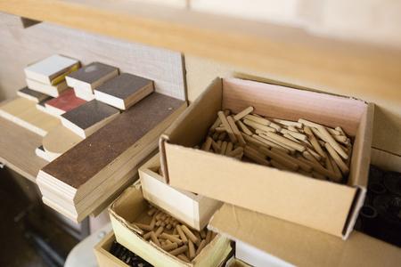 wood dowel pins and board samples at workshop