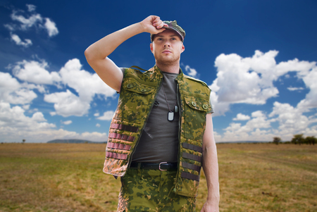 soldier in military uniform over sky background