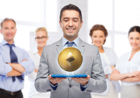 smiling businessman with etherum over tablet pc