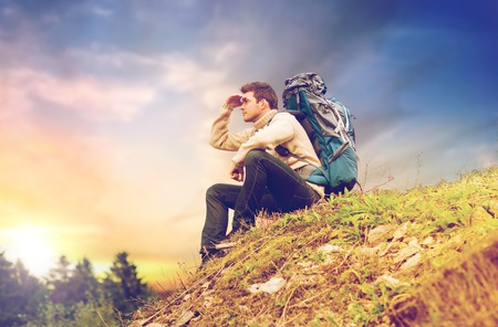 traveler with backpack hiking over sky background Stock fotó