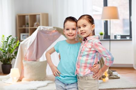 happy smiling little girls hugging at home Standard-Bild