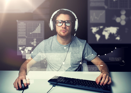 man in headset with computer over virtual screens Standard-Bild