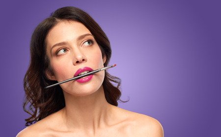 beautiful woman with make up brush for lipstick Standard-Bild