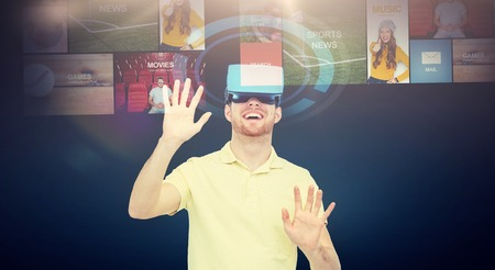 happy man in virtual reality headset or 3d glasses