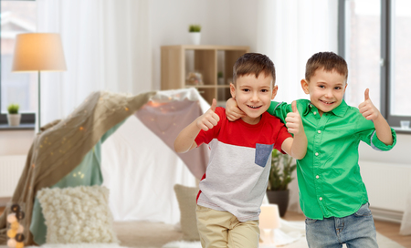 happy smiling little boys showing thumbs up Standard-Bild