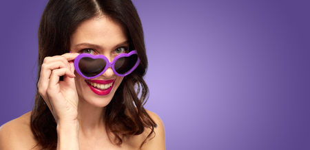 woman with ultra violet heart shaped shades
