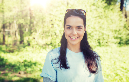 happy young volunteer woman outdoors