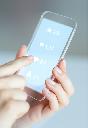 hands with social media icons on smartphone Stock Photo