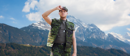 soldier in military uniform over mountains