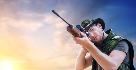soldier or hunter with gun aiming or shooting Stock Photo - 97896062