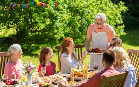 happy family having dinner or summer garden party Stock Photo