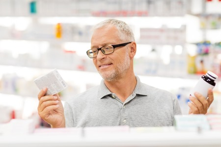 senior male customer choosing drugs at pharmacy Stock Photo