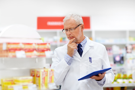 senior with tablet pc at pharmacy Stock Photo