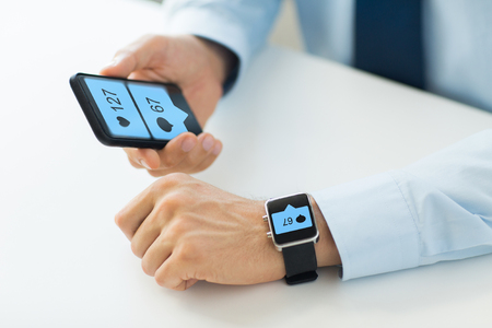 hands with smartphone and smart watch social media