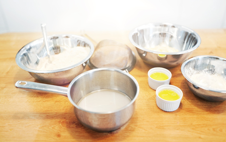 bowls with flour and egg whites at bakery kitchen