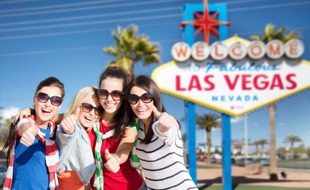 group of happy women or friends at las vegas 版權商用圖片