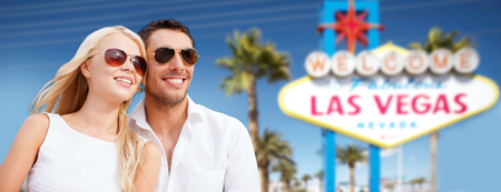 couple in shades over las vegas sign at summer 스톡 콘텐츠
