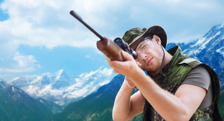 soldier or hunter with gun aiming or shooting Stock Photo - 98117467