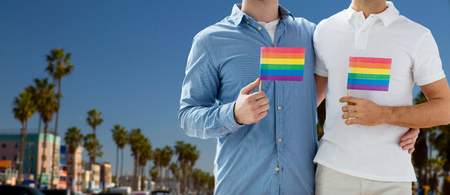 male couple with gay pride flags in los angeles