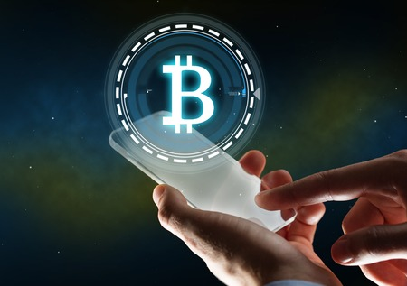 businessman with tablet pc and bitcoin hologram Foto de archivo