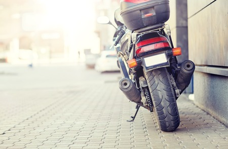 close up of motorcycle parked on city street