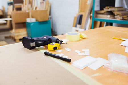 screwdriver and ruler on table at workshop