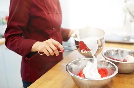 chef making macaron batter at kitchen