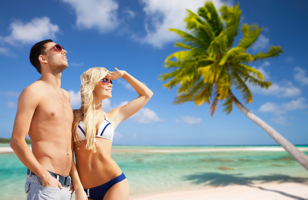 happy couple on over exotic tropical beach