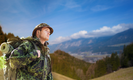 soldier in military uniform with backpack hiking