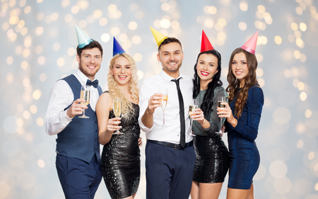 friends with champagne glasses at birthday party