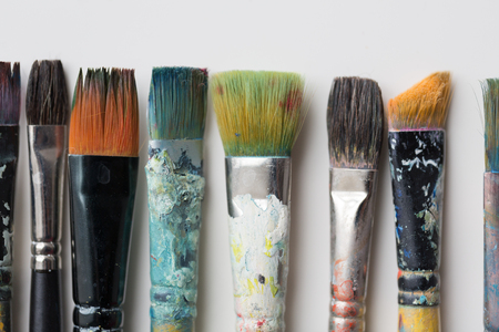 close up of dirty paintbrushes from top Imagens