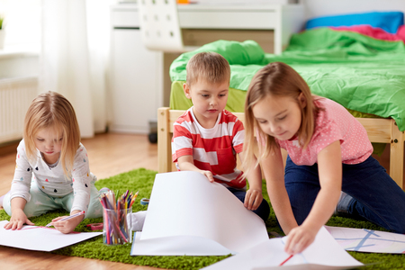 happy kids drawing at home Stock Photo