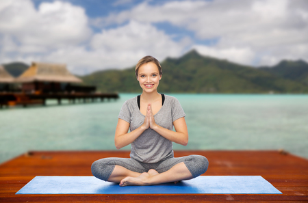 woman making yoga in and meditating lotus pose Banque d'images