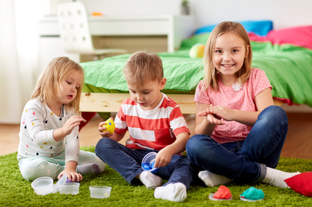 kids with modelling clay or slimes at home Stock Photo