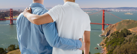close up of gay couple over golden gate bridge