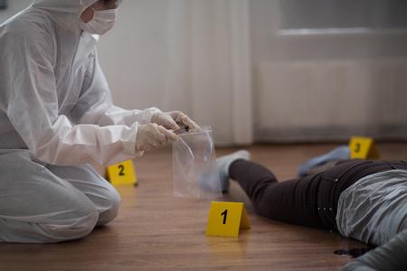 criminalist collecting crime scene evidence Stock fotó