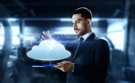 businessman with transparent tablet and cloud Stock Photo