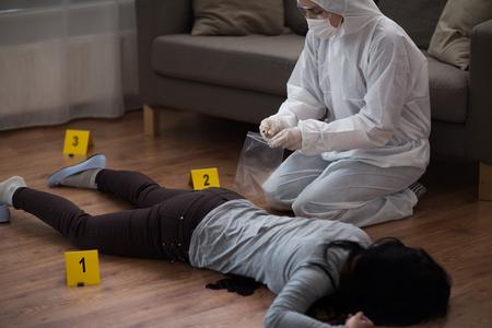 criminalist collecting crime scene evidence Stock Photo