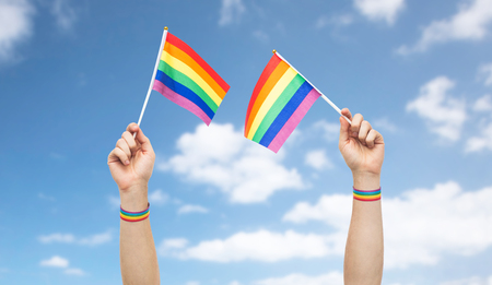 hand with gay pride rainbow flags and wristbands Banco de Imagens - 99842965