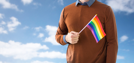 close up of man with gay pride rainbow flag Stock fotó