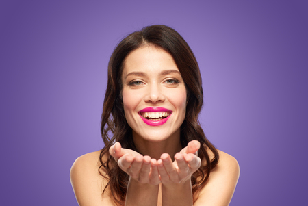 beautiful smiling young woman with pink lipstick
