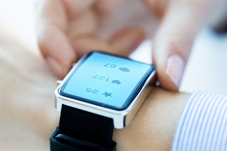 close up of smart watch with social media icons