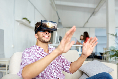 happy man with virtual reality headset at office Stock Photo