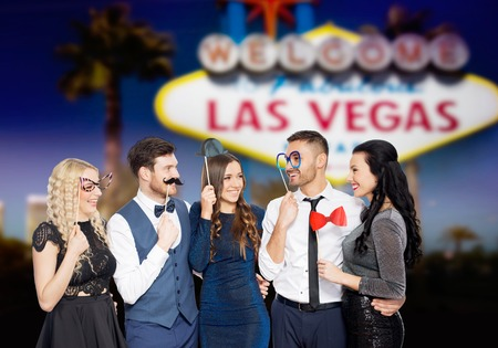 happy friends with party props in las vegas