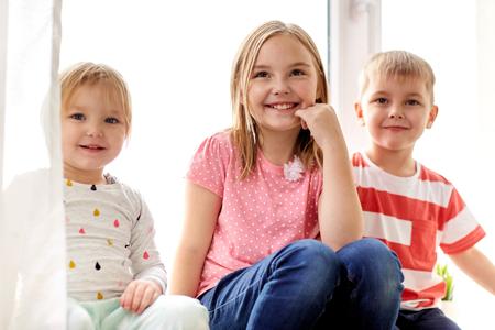 happy little kids having fun at window Stockfoto