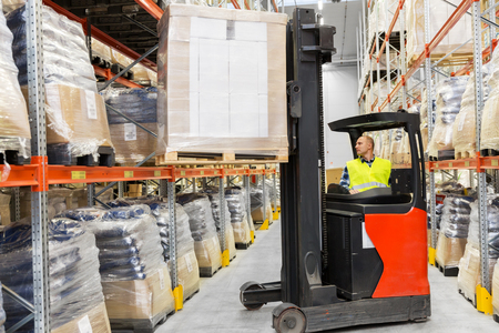 loader operating forklift at warehouse