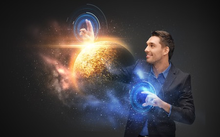 businessman with virtual planet and space hologram