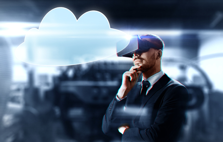 businessman with virtual reality headset and cloud Stock Photo