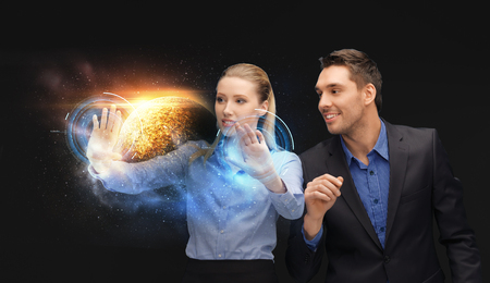 businessman and businesswoman with planet hologram